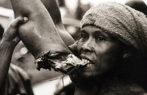 Cannibal_eating_arm_brains_body_wazaap-300x194