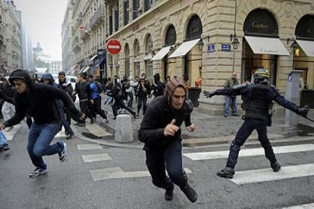 Guy running away from crowd